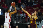 Wisconsin's Aleem Ford (2) shoots against Minnesota's Alihan Demir (30) during the first half of an NCAA college basketball game Sunday, March 1, 2020, in Madison, Wis. (AP Photo/Andy Manis)