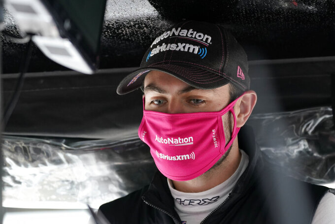 Jack Harvey, of England, waits in his pit box during a practice session for the IndyCar auto race at Indianapolis Motor Speedway, Thursday, Oct. 1, 2020, in Indianapolis. (AP Photo/Darron Cummings)