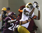File-This Oct. 6, 2018, file photo shows Notre Dame wide receiver Miles Boykin (81) making a catch over Virginia Tech defensive back Jovonn Quillen (26) during the second half of an NCAA college football game in Blacksburg, Va. Notre Dame defensive captain Drue Tranquill and leading receiver Boykin weren't even Fighting Irish fans the last time they had a 12-0 regular season. Maybe that was a good thing since those current players didn't have to suffer through how that season ended. (AP Photo/Steve Helber, File)