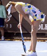 Amanda Anisimova of the U.S. reacts during her first round match against Zarina Diyas of Kazakhstan at the Australian Open tennis championship in Melbourne, Australia, Tuesday, Jan. 21, 2020. (AP Photo/Andy Brownbill)