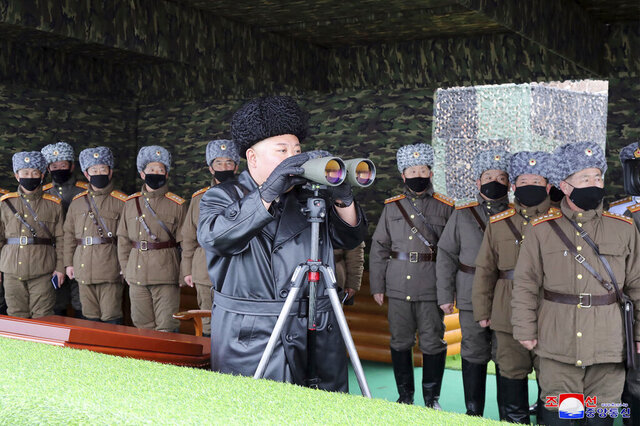 FILE - In this Friday, Feb. 28, 2020, file photo provided on Feb. 29, 2020 by the North Korean government, North Korean leader Kim Jong Un, center, inspects the military drill of units of the Korean People's Army, with soldiers shown wearing face masks. Independent journalists were not given access to cover the event depicted in this image distributed by the North Korean government. The content of this image is as provided and cannot be independently verified. Korean language watermark on image as provided by source reads: