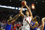 Arizona center Chase Jeter (4) scores against San Jose State during the second half of an NCAA college basketball game Thursday, Nov. 14, 2019, in Tucson, Ariz. Arizona won 87-39. (AP Photo/Rick Scuteri)