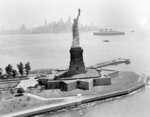FILE - In this June 29, 1954, file photo, the Statue of Liberty stands in New York Harbor as the ocean liner Queen Mary goes past as seen from a U.S. Coast Guard helicopter. (AP Photo/File)