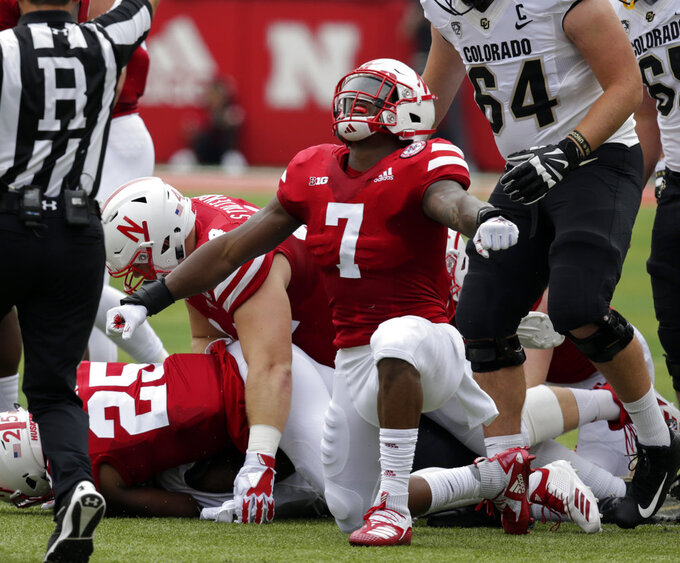 FILE - In this Sept. 8, 2018, file photo, Nebraska linebacker Mohamed Barry (7) celebrates a sack of Colorado quarterback Steven Montez (12) during the first half of an NCAA college football game in Lincoln, Neb. If Nebraska needs any extra incentive to pick up its elusive first win Saturday, players who were on the field against Minnesota last year need only remember what happened in that game. (AP Photo/Nati Harnik, File)