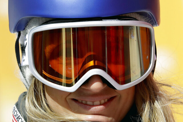 FILE - In this Feb. 12, 2018, file photo, Anna Gasser, of Austria, smiles after her run during the women's slopestyle final at the 2018 Winter Olympics in Pyeongchang, South Korea. Gasser cleaned out her closet in Austria over the weekend and found nine pairs of snow goggles. They're all being shipped off, including the one she's pretty certain she wore at the 2018 Pyeongchang Games. Destination: Health-care workers. (AP Photo/Lee Jin-man, File)