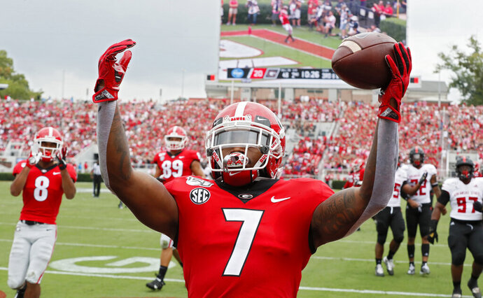 Georgia Bulldogs running back D'Andre Swift (7) scores on a pass play which he broke for a touchdown during the first half of todays Georgia vs Arkansas State NCAA football game at Sanford Stadium in Athens. (Bob Andres/Atlanta Journal-Constitution via AP)