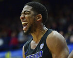 Buffalo guard CJ Massinburg reacts after a dunk during the second half of an NCAA college basketball game against Kent State, Friday, Jan. 25, 2019, in Kent, Ohio. (AP Photo/David Dermer)