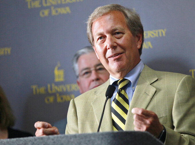 FILE - In this Sept. 3, 2015, file photo, Bruce Harreld speaks to media after he was introduced as the new University of Iowa president during a news conference in Iowa City, Iowa. Harreld announced plans on Thursday, Oct. 1, 2020, to retire after the school's board finds his successor. Harreld, a former corporate executive and Harvard Business School instructor, has led the Big Ten university since 2015. (David Scrivner/Iowa City Press-Citizen via AP, File)