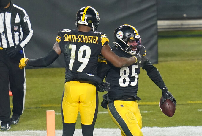 Pittsburgh Steelers tight end Eric Ebron (85) celebrates with JuJu Smith-Schuster after scoring during the second half of an NFL wild-card playoff football game against the Cleveland Browns, Sunday, Jan. 10, 2021, in Pittsburgh. (AP Photo/Keith Srakocic)