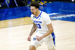 Creighton's Christian Bishop celebrates after scoring against UC Santa Barbara during the first half of a college basketball game in the first round of the NCAA tournament at Lucas Oil Stadium in Indianapolis Saturday, March 20, 2021. (AP Photo/Mark Humphrey)