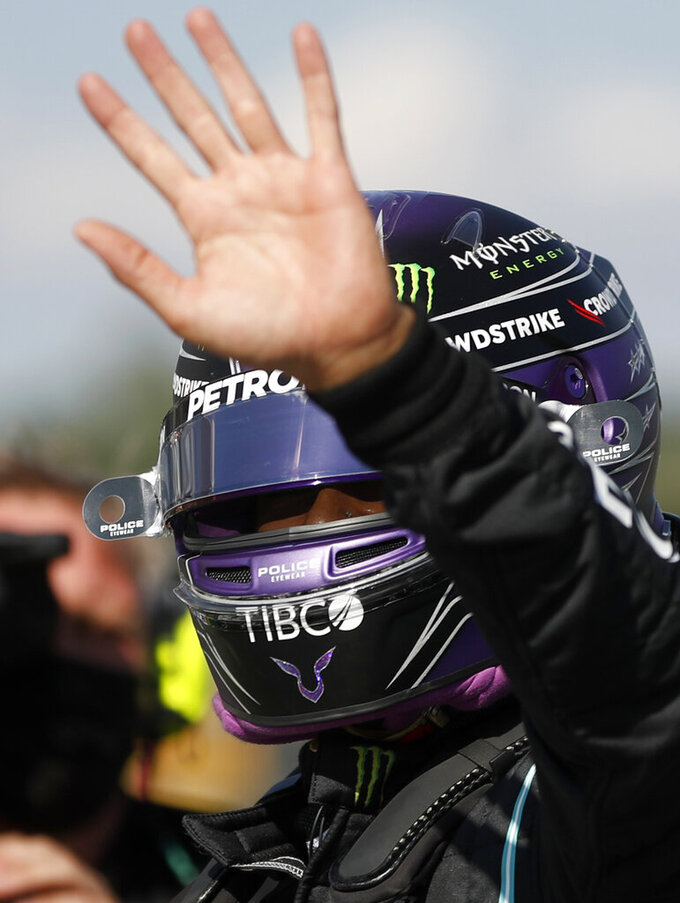 Mercedes driver Lewis Hamilton of Britain celebrates after he clocked the fastest time during the qualifying session for the Hungarian Formula One Grand Prix, at the Hungaroring racetrack in Mogyorod, Hungary, Saturday, July 31, 2021. The Hungarian Formula One Grand Prix will be held on Sunday. (David W Cerny/Pool via AP)