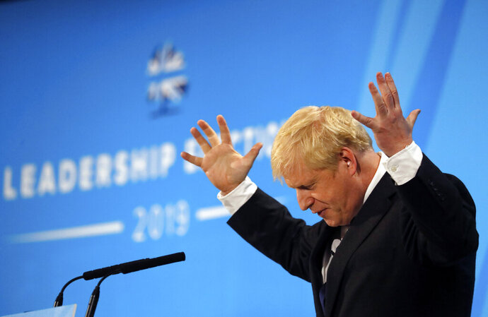 Conservative party leadership candidate Boris Johnson gestures while delivering his speech during a Conservative leadership hustings at ExCel Centre in London, Wednesday, July 17, 2019. The two contenders, Jeremy Hunt and Boris Johnson are competing for votes from party members, with the winner replacing Prime Minister Theresa May as party leader and Prime Minister of Britain's ruling Conservative Party. (AP Photo/Frank Augstein)