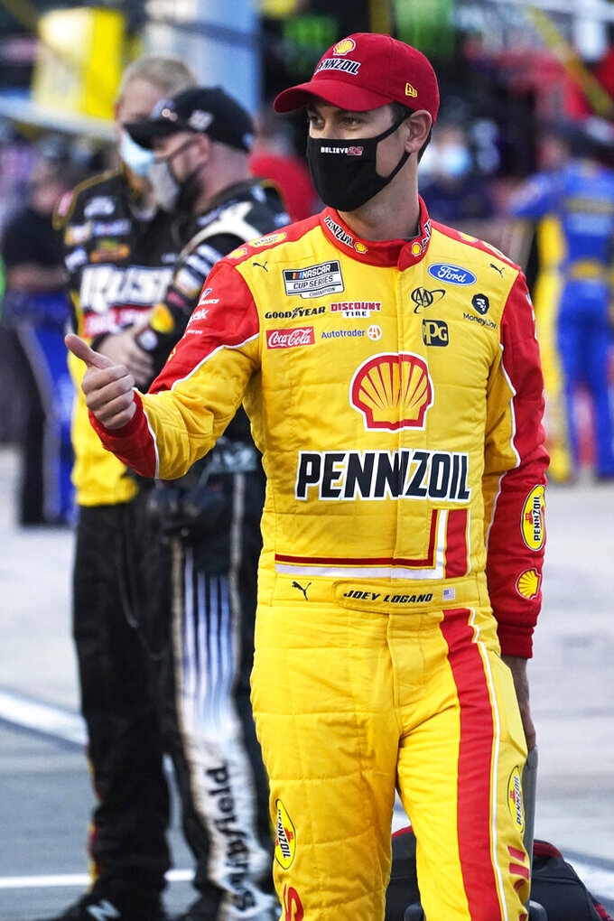 Joey Logano walks to his car prior to the start of a NASCAR Cup Series auto race Saturday, Sept. 12, 2020, in Richmond, Va. (AP Photo/Steve Helber)