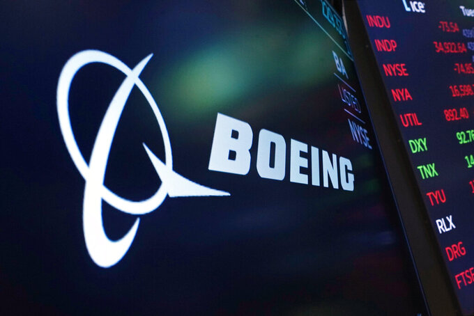 FILE - The logo for Boeing appears on a screen above a trading post on the floor of the New York Stock Exchange, Tuesday, July 13, 2021. Despite the pandemic's damage to air travel, Boeing says it's optimistic about long-term demand for airplanes. Boeing said Tuesday, Sept. 14, 2021 that it expects the aerospace market to be worth $9 trillion over the next decade. That includes planes for airlines and military uses and other aerospace products and services. (AP Photo/Richard Drew, file)
