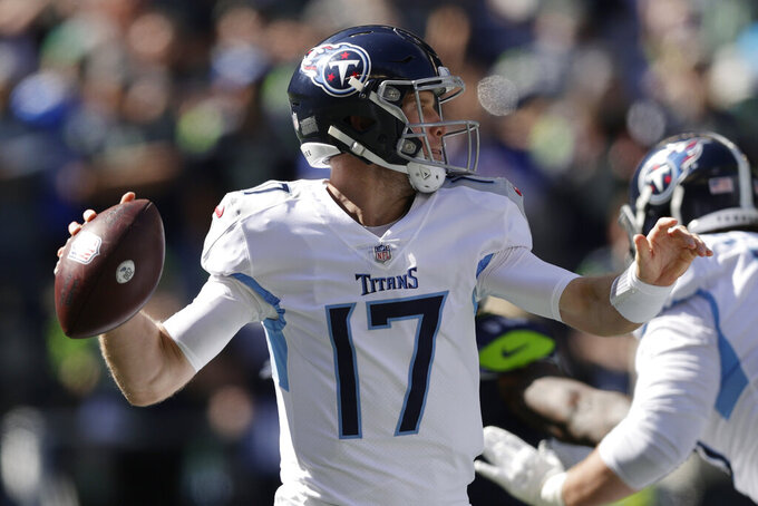 Tennessee Titans quarterback Ryan Tannehill passes against the Seattle Seahawks during the first half of an NFL football game, Sunday, Sept. 19, 2021, in Seattle. (AP Photo/John Froschauer)