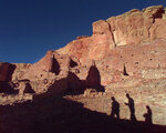 FILE - In this Nov. 21, 1996, file photo, tourists cast their shadows on the ancient Anasazi ruins of Chaco Canyon in N.M. Research suggests three archaeological sites in the Southwest: Chaco Canyon, Aztec Ruins and Casas Grandes represent three successive stages of the same political regime. Native American leaders are banding together to pressure U.S. officials to ban oil and gas exploration around a sacred tribal site that features massive stone structures and other remnants of an ancient civilization. Tribes are gathering Thursday, March 21, 2019, to face the Trump administration's pro-drilling stance as they push for further protections surrounding Chaco Culture National Historical Park. (AP Photo/Eric Draper, File)