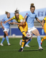 Tottenham Hotspur's Josie Green, left, and Manchester City's  and Sam Mewis vie for the ball, during the Women's Super League soccer match between Manchester City and Tottenham Hotspur, at the Academy Stadium, Manchester, England,  Sunday Oct. 4, 2020. (AP Photo/Dave Thompson)