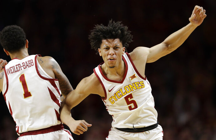 Iowa State guard Lindell Wigginton (5) celebrates with teammate Nick Weiler-Babb (1) after making a 3-point basket during the first half of an NCAA college basketball game against Baylor, Saturday, Jan. 13, 2018, in Ames, Iowa. (AP Photo/Charlie Neibergall)