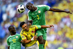 FILE - In this June 28, 2018, file photo, Colombia's Radamel Falcao, center, jumps for the ball with Senegal's Kalidou Koulibaly, right, and Senegal's Youssouf Sabaly, left, during the group H match between Senegal and Colombia, at the 2018 soccer World Cup in the Samara Arena in Samara, Russia. The photo was honored by the Associated Press Sports Editors as best sports action photo of 2018 at their annual winter meeting in in Lake Buena Vista, Fla. (AP Photo/Martin Meissner, File)