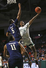 Miami guard Anthony Lawrence II (2) goes to the basket against Notre Dame guard D.J. Harvey (5) during the second half of an NCAA college basketball game, Wednesday, Feb. 6, 2019 in Coral Gables, Fla. (David Santiago/Miami Herald via AP)