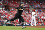 Colorado Rockies' Garrett Hampson, left, rounds the bases after hitting a solo home run off St. Louis Cardinals starting pitcher Michael Wacha during the second inning of a baseball game Sunday, Aug. 25, 2019, in St. Louis. (AP Photo/Jeff Roberson)
