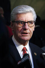 FILE - In this Jan. 20, 2019 file photograph, Gov. Phil Bryant explains to reporters the advantages of passing and signing the Mississippi Broadband Enabling Act, at the Capitol in Jackson, Miss. Mississippi's white Republican governor Bryant and U.S. Rep. Bennie Thompson, the state's only black Democratic congressman are feuding over who should get credit for the home of a slain civil rights leader becoming a national monument. Thompson says he has worked on the issue for 16 years. (AP Photo/Rogelio V. Solis, File)