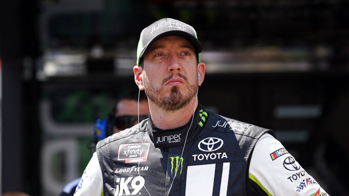 Drive Kyle Busch watches from the pits during practice for an NASCAR Xfinity Series auto race on Thursday, Aug. 15, 2019, in Bristol, Tenn. (AP Photo/Wade Payne)