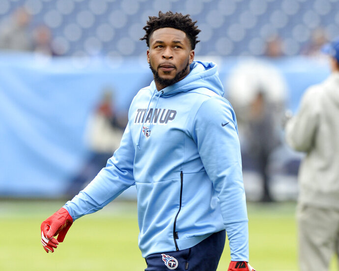 FILE - In this Dec. 15, 2019, file photo, Tennessee Titans free safety Kevin Byard walks on the field before an NFL football game against the Houston Texans in Nashville, Tenn. Byard has the most interceptions in the NFL since the start of the 2017 season, yet his biggest catch came at home. He wound up delivering his son when his wife's contractions prevented them from getting to the hospital. (AP Photo/Mark Zaleski, File)