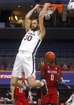 Virginia forward Jay Huff (30) dunks next to North Carolina State forward DJ Funderburk (0) during an NCAA college basketball game Wednesday, Feb. 24, 2021, in Charlottesville, Va. (Andrew Shurtleff/The Daily Progress via AP, Pool)