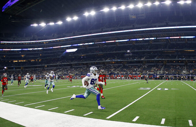 Dallas Cowboys wide receiver Jalen Guyton (83) runs past Tampa Bay Buccaneers linebacker Emmanuel Smith (43) into the end zone for a touchdown after catching a pass in the second half of a preseason NFL football game in Arlington, Texas, Thursday, Aug. 29, 2019. (AP Photo/Ron Jenkins)