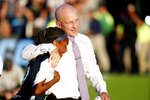 Carolina Courage head coach Paul Riley, right, hugs Crystal Dunn (19) following the team's win over the Chicago Red Stars in an NWSL championship soccer game in Cary, N.C., Sunday, Oct. 27, 2019. (AP Photo/Karl B DeBlaker)