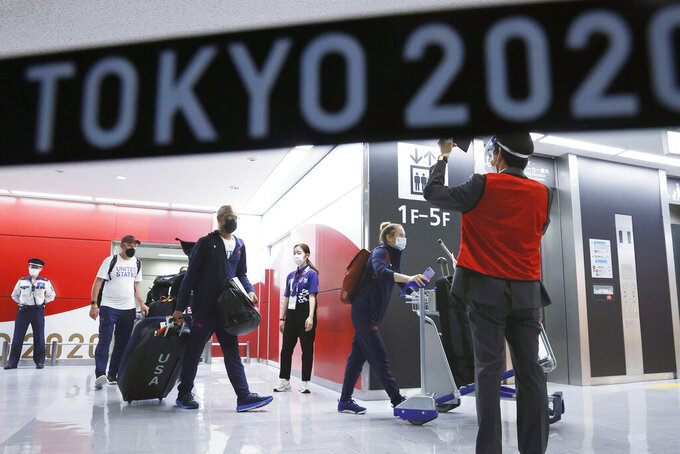 The Olympic athletes from the United States arrive at Narita International Airport in Narita, east of Tokyo, on July 1, 2021. Tens of thousands of visiting athletes, officials and media are descending on Japan for a Summer Olympics unlike any other. There will be no foreign fans, no local fans in Tokyo-area venues. A surge of virus cases has led to yet another state of emergency. (Kyodo News via AP)