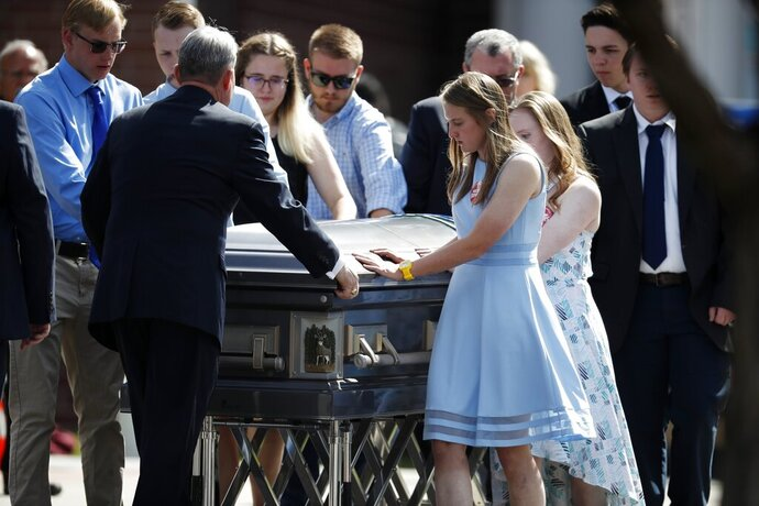 Pallbearer guide the casket to a waiting hearse after the memorial service for Kendrick Castillo, who was killed in the assault on the STEM Highlands Ranch School, Wednesday, May 15, 2019, in Highlands Ranch, Colo. (AP Photo/David Zalubowski)