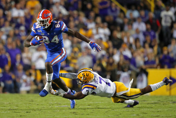 Florida tight end Kyle Pitts (84) carries against LSU safety Grant Delpit (7) in the first half of an NCAA college football game in Baton Rouge, La., Saturday, Oct. 12, 2019. (AP Photo/Gerald Herbert)