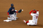 Philadelphia Phillies' Didi Gregorius, right, steals second past Atlanta Braves second baseman Adeiny Hechavarriaduring the fourth inning of a baseball game, Saturday, Aug. 8, 2020, in Philadelphia. (AP Photo/Matt Slocum)