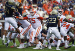 FILE - In this Sept. 22, 2018, file photo, Clemson offensive tackle Mitch Hyatt (75) works against Georgia Tech during the first half of a game in Atlanta. Hyatt was named to the 2018 AP All-America NCAA college football team, Monday, Dec. 10, 2018. (AP Photo/Jon Barash, mFile)