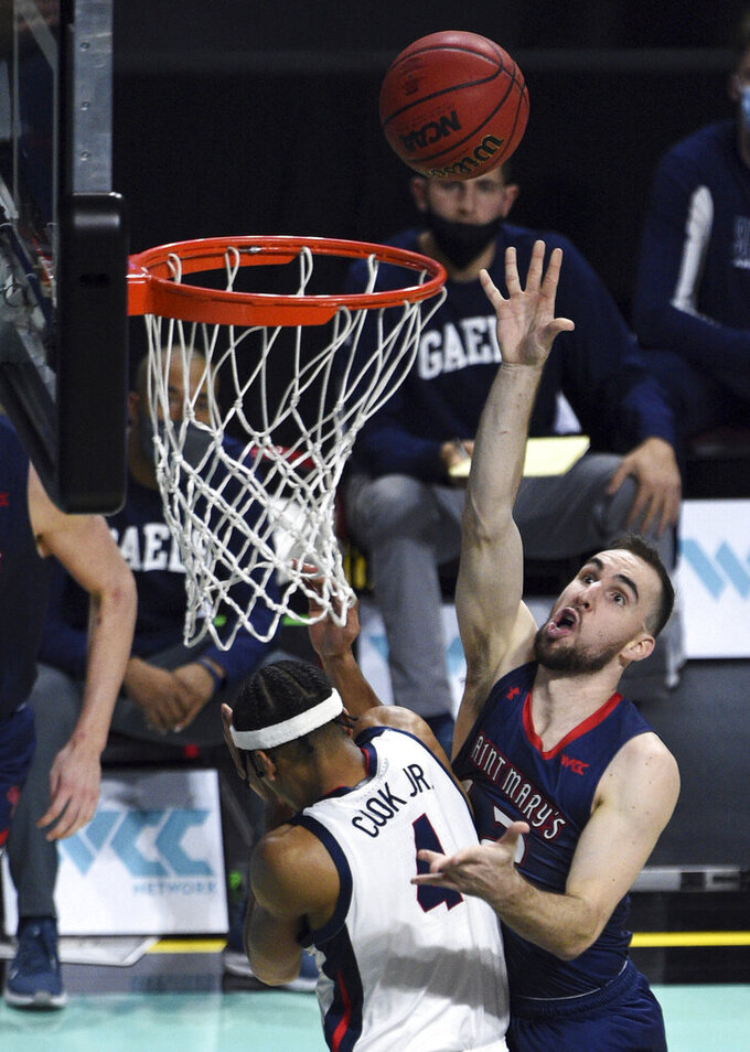 Saint Mary's guard Tommy Kuhse (12) shoots /against Gonzaga guard Aaron Cook during the second half of an NCAA semifinal college basketball game at the West Coast Conference tournament Monday, March 8, 2021, in Las Vegas. (AP Photo/David Becker)
