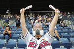 A fan wearing a face masks to help protect against the spread of the new coronavirus cheers during the KBO league game between Doosan Bears and LG Twins in Seoul, South Korea, Sunday, July 27, 2020. Masked fans hopped, sang and shouted cheering slogans in baseball stadiums in South Korea on Sunday as authorities began bringing back spectators in professional sports games amid the coronavirus pandemic. (AP Photo/Ahn Young-joon)