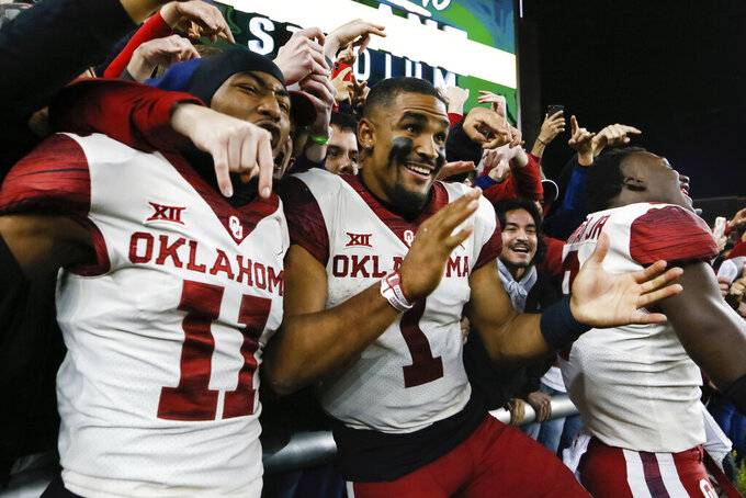 Oklahoma cornerback Parnell Motley (11) and quarterback Jalen Hurts (1) celebrate the 34-31 victory over Baylor following an NCAA college football game in Waco, Texas, Saturday, Nov. 16, 2019. (AP Photo/Ray Carlin)