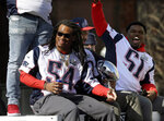 New England Patriots' Dont'a Hightower, left, and Ja'Whaun Bentley parade through downtown Boston, Tuesday, Feb. 5, 2019, to celebrate their win over the Los Angeles Rams in Sunday's NFL Super Bowl 53 football game in Atlanta. (AP Photo/Steven Senne)