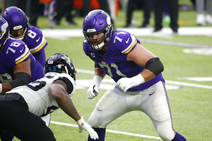FILE - In this Dec. 6, 2020, file photo, Minnesota Vikings offensive tackle Riley Reiff (71) looks to make a block during the second half of the team's NFL football game against the Jacksonville Jaguars in Minneapolis. The Vikings made their costliest move yet for salary cap compliance Wednesday, March 10, 2021, by terminating the contract of Reiff with one year left on it, weakening an offensive line that was already in need of some upgrades. Though Reiff plays a critical position and 2020 was by most measures the best of his four seasons with the Vikings, cutting him will trim $11.75 million off the team's cap charges. (AP Photo/Bruce Kluckhohn, File)