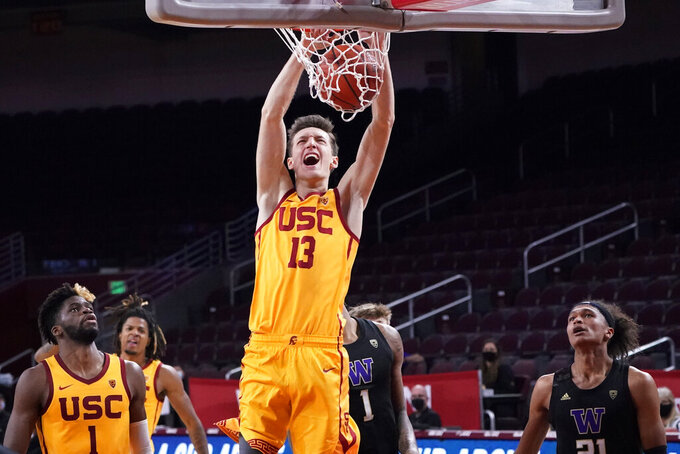 Southern California guard Drew Peterson (13) dunks against Washington during the second half of an NCAA college basketball game Thursday, Jan. 14, 2021, in Los Angeles. (AP Photo/Marcio Jose Sanchez)