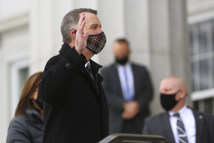 Vermont Gov. Phil Scott takes the Oath of Office on on the steps of the Vermont Statehouse on Thursday, Jan. 7, 2021 Montpelier, Vt. Scott, a Republican, is beginning his third two-year term. (AP Photo/Wilson Ring)