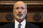 FILE - In this Aug. 15, 2019 file photo Gov. Tom Wolf speaks during a news conference at City Hall in Philadelphia. Wolf is urging the passage of a law in Pennsylvania requiring gun owners to report stolen or lost firearms, suggesting it would have prevented last week's shooting of six Philadelphia police officers during a long standoff. (AP Photo/Matt Rourke, File)