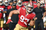 FILE - In this Oct. 13, 2019, file photo, San Francisco 49ers defensive lineman Nick Bosa (97) rushing the quarterback during an NFL football game against the Los Angeles Rams, in Los Angeles. Six months after Kyler Murray was drafted No. 1 by Arizona one spot ahead of him, San Francisco defensive end Nick Bosa gets his opportunity to chase Murray down when the 49ers visit the Cardinals this week.  (AP Photo/John Cordes, File)