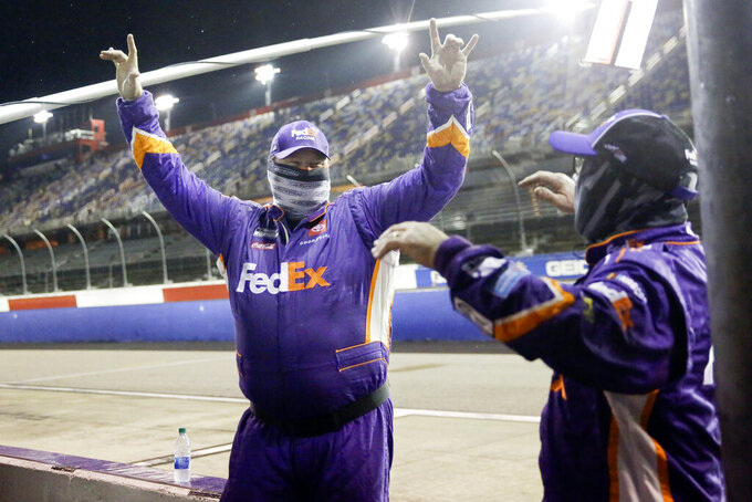 Members of Denny Hamlin's crew celebrate after Hamlin won the rain-shortened NASCAR Cup Series auto race Wednesday, May 20, 2020, in Darlington, S.C. (AP Photo/Brynn Anderson)