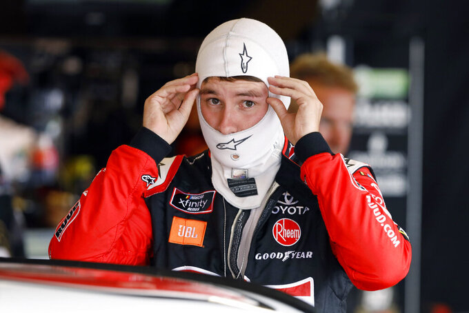 Christopher Bell prepares to get into his car for practice for a NASCAR Xfinity Series auto race, Saturday, June 15, 2019, at Iowa Speedway in Newton, Iowa. (AP Photo/Charlie Neibergall)