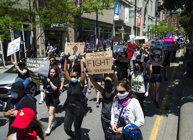 Thousands of people protest at an anti-racism demonstration, in Toronto on Friday, June 5, 2020. George Floyd, a black man, died after he was restrained by Minneapolis police officers on May 25. His death has ignited protests in the U.S. and worldwide over racial injustice and police brutality. (Nathan Denette/The Canadian Press via AP)