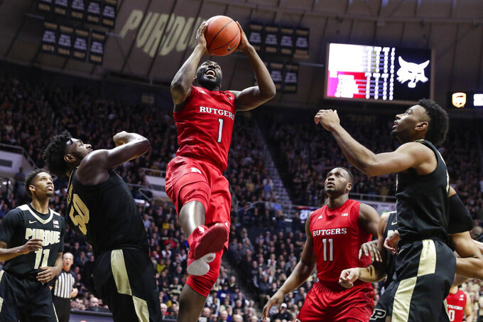 Rutgers forward Akwasi Yeboah (1) shoots between Purdue forwards Trevion Williams (50) and Aaron Wheeler (1) during the first half of an NCAA college basketball game in West Lafayette, Ind., Saturday, March 7, 2020. (AP Photo/Michael Conroy)