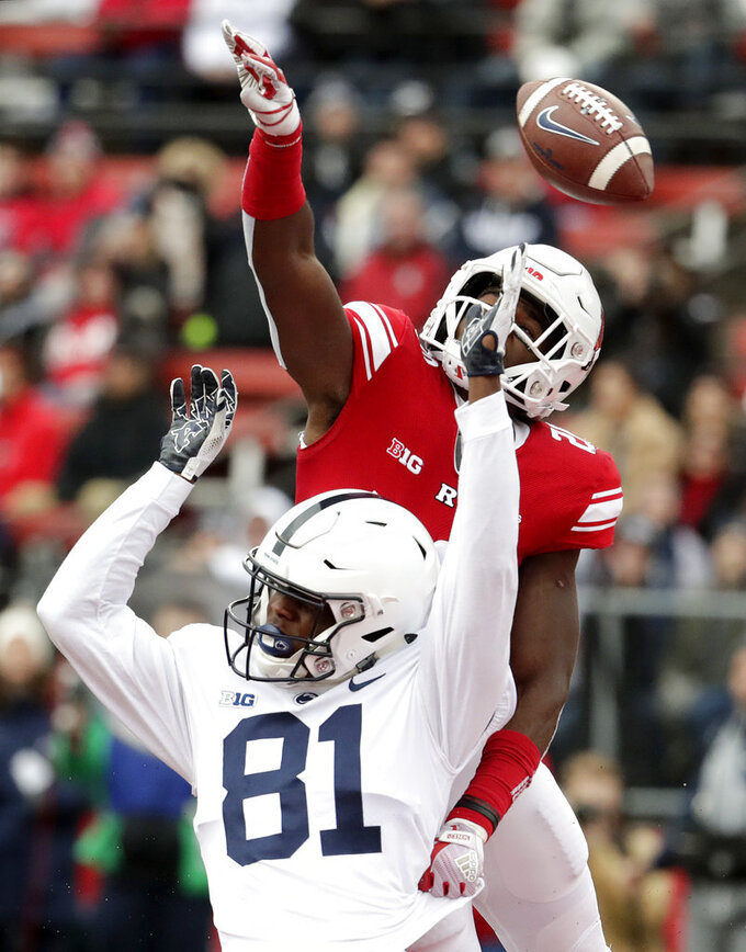 Rutgers defensive back Avery Young, top, tries to deflect a pass from Penn State quarterback Trace McSorley, not pictured, intended for wide receiver Cam Sullivan-Brown during the first half of an NCAA college football game, Saturday, Nov. 17, 2018, in Piscataway, N.J. Young was called for a pass interference penalty on the play. (AP Photo/Julio Cortez)